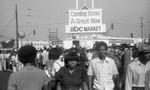 ABC Market recruitment event participants gathering in a parking lot, Los Angeles, 1983