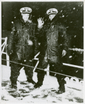 Thumbnail for Two African American Navy officers, [left to right] Ensign J. J. Jenkins and Clarence Samuels, aboard a cutter on the North Atlantic patrol