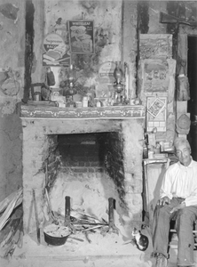 A fireplace in an old mud hut which was built and is still lived in by a French-mulatto family, near the John Henry plantation. Melrose, Louisiana
