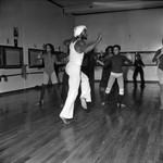 Dance class with instructor in white