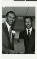 Black and white photograph of Roosevelt Toston and Dr. Paul Meacham (President of the College of Southern Nevada)
