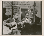 Group portrait of King Cole Trio, (left to right) Oscar Moore (guitar), Nat King Cole (piano) and Leslie Prince (double bass), during a broadcast on NBC Radio, circa 1940