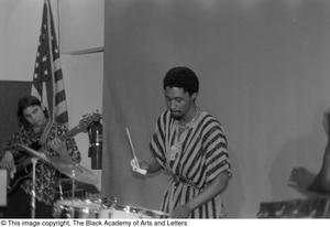[Photograph of drummer performing with band mates at conference for Black Women in the Arts] Conference on Black Women in the Arts