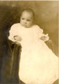 Unidentified baby in gown