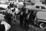 Martin Luther King, Jr., William M. Branch, Ralph Abernathy and others, greeting people after getting out of a car, probably outside First Baptist Church in Eutaw, Alabama.