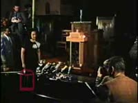 WSB-TV newsfilm clip of Coretta Scott King following the assassination of her husband, Dr. Martin Luther King, Jr., speaking at a press conference held at Ebenezer Baptist Church, Atlanta, Georgia, 1968 April 6