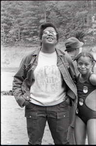 African American woman (possibly at a summer camp) wearing a Spirit in Flesh t-shirt