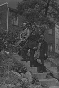 Jack, Herman, and Anne standing on steps