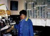 "Photograph of Debbie Conway hosting the radio show ""Economic Empowerment into the 21st Century,"" circa 1998"
