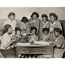 Girl Scout troop at table with typewriter