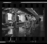 Four boys mopping barracks at Camp Roberts as part of summer camp program, Calif., 1967