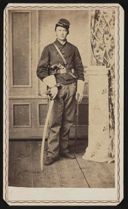 [Unidentified soldier in Union cavalry uniform with saber and revolver]