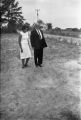 Dr. and Mrs. H. D. Monteith Inspect a Bomb Crater
