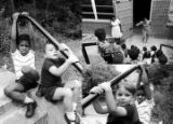 Images of children outside a brick building, possibly during a summer program.