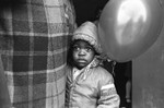 A child holds a balloon, Los Angeles, 1983