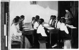 Sister Gabriella Mulherin, MM, conducts class at Industrial School, Yeng You, Korea, ca. 1920-1940