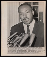 Martin Luther King, before microphones after conference with President Kennedy regarding desegregation under 14th Amendment. 20th century photograph, 10 x 8