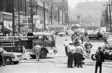 Firemen and police officers standing in the street during the Children's Crusade in Birmingham, Alabama.