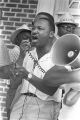 """Martin Luther King, Jr., addressing an audience in front of the Neshoba County Library in Philadelphia, Mississippi, during the """"March Against Fear"""" begun by James Meredith."""