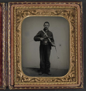 [Unidentified soldier in Union cavalry uniform with Colt Dragoon revolver and sword]