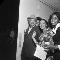 Redd Foxx with young women, probably in Birmingham, Alabama.