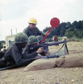 Soldier shooting an M16 rifle at the U.S. Army training facility at Fort McClellan near Anniston, Alabama.