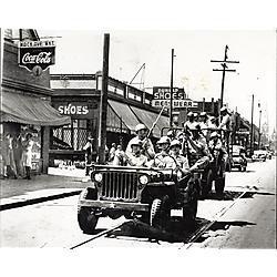 Soldiers in two jeeps on Mack Street, Detroit