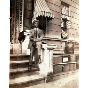 African American man sitting outside