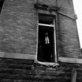 African American man standing in an open doorway at 16th Street Baptist Church in Birmingham, Alabama, after the building was bombed.