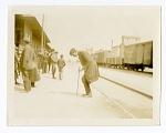 African-American Man Dancing at Railroad Station