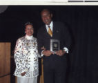 Photograph of Xerona Clayton Brady and Roosevelt Toston at the Trumpet Awards, 2002