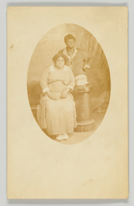 Photographic postcard of two women unidentified women
