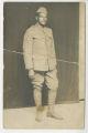 Portrait of Millage Gomillion standing in uniform
