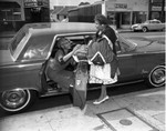 Woman in automobile, Los Angeles, 1963