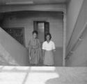Susie Sanders and Shirley Martin walking up the stairs at Sidney Lanier High School in Montgomery, Alabama.