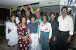 Donald Bohana posing with friends and family at his birthday party, Los Angeles, 1989