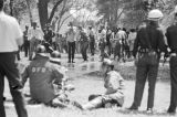 Young civil rights demonstrators pointing at the fire fighters who had sprayed them with a hose in Kelly Ingram Park during the Children's Crusade in Birmingham, Alabama.