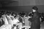 Career Day lecturer addressing students in an auditorium, Los Angeles, 1985