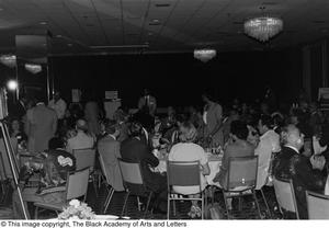Photograph of the backs of unidentified guests sitting at various dining tables Jack Evans Breakfast with JBAAL