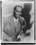[Charlie Parker, half-length portrait, facing front, holding saxophone]