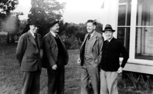 Unidentified group of men. Jackson Davis wearing a hat.