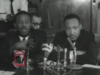 WSB-TV newsfilm clip of a press conference where Dr. Martin Luther King, Jr., Reverend Ralph D. Abernathy, and Albany Movement president Dr. William G. Anderson speak after King and Abernathy were mysteriously released from jail in Albany, Georgia, 1962 July 12