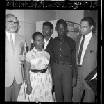 Attorney A. L. Wirin with Rena Frye and her sons, Ronald and Marquette at Los Angeles courthouse, 1965