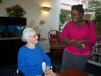Evelyn Estevan Talks with a Student, circa 2009