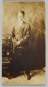Photographic postcard of a man in a double-breasted jacket