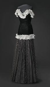 Black and silver drop waist dress with ruffle details designed by Peter Davy
