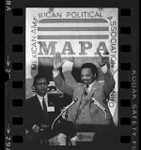 Presidential candidate, Jesse Jackson at podium addressing Mexican American Political Association in San Jose, Calif., 1984