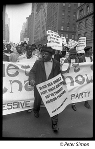 Harlem Peace March: Progressive Labor Party march behind banner reading 'Get out of Vietnam now': African American antiwar protesters marching through the New York streets, one with sign reading 'Black men should fight white racism, not Vietnamese freedom fighters