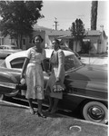 Women leaned against a car, Los Angeles, 1955