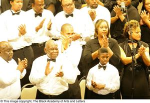 Choir members clapping Black Music and The Civil Rights Movement Concert, featuring Chrisette Michele & Ledisi.